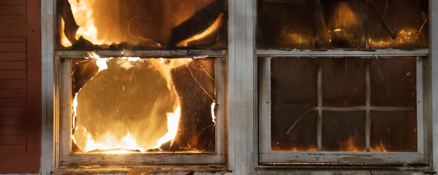 fire-flames-devour-the-window-of-a-vacant-home-during-a-controlled-burn-exercise-for-firefighters_t20_PQPQ1d
